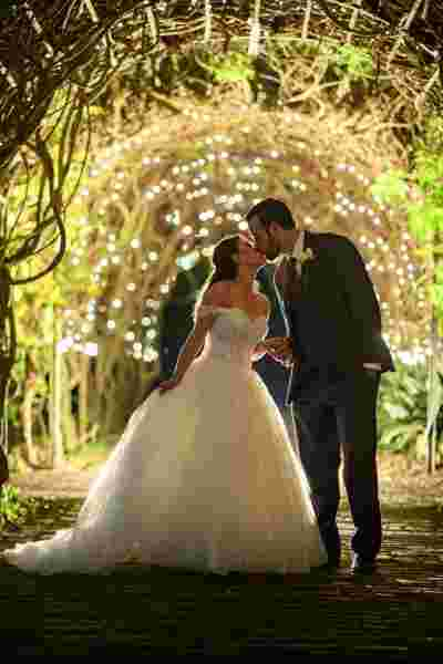 Best Professional Luxury Dream Wedding Photography Outdoor Wedding Night Bride Groom Kiss Under Pretty Lights at Houmas House Plantation Louisiana Photo 45